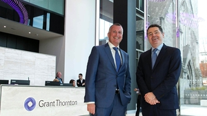 Managing Partner of Grant Thornton Mick McAteer and Finance Minister Paschal Donohoe at the today's jobs announcement