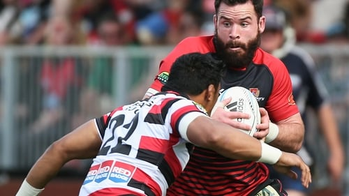Ryan Crotty of Canterbury gets tackled by Counties Manukau centre Bundee Aki in 2013