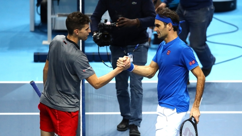 Roger Federer and Dominic Thiem after their match
