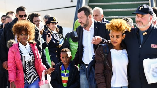 Mr Salvini greeting the migrant group at a military airport near Rome today