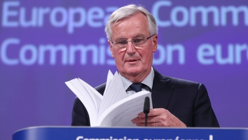 Michel Barnier holding a copy of the draft withdrawal agreement in Brussels