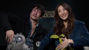 Ezra Miller and Claudia Kim in puppet-pose