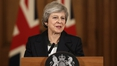 May vows to fight for Brexit deal despite criticism