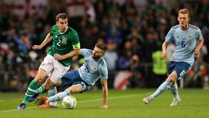 Ireland's Seamus Coleman with Stuart Dallas of Northern Ireland in the Three International Friendly at the Aviva Stadium, Dublin in November 2018. Photo: INPHO/Ryan Byrne