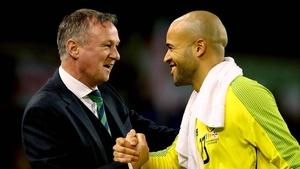 Michael O'Neill congratulates Darren Randolph on his display
