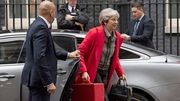 Theresa May said she will travel to Brussels this week