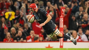 Cory Hill of Wales dives in for his sides seventh try