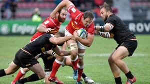 Canada's scrum half Phil Mack tries to escape a tackle