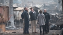 US President Donald Trump (centre) visits the ravaged town of Paradise in California