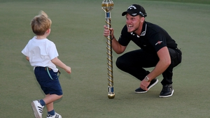 Danny Willett celebrates with his son