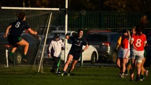 Róisín McGovern of Foxrock-Cabinteely (C) celebrates scoring her side's last-minute goal