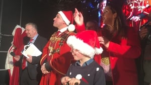 CervicalCheck campaigner Vicky Phelan, along with members of her family, switched on the lights