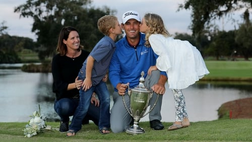 Charles Howell III of the United States poses with his wife Heather and their kids Charles and Ashley