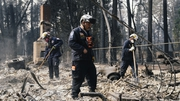 Search and rescue workers comb debris in Paradise, California