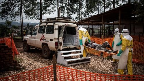 Médecins Sans Frontières health workers move a patient to hospital