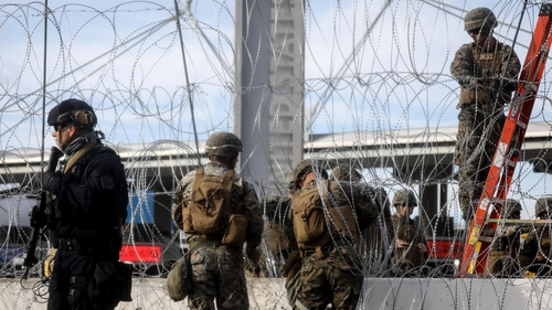 US troops set up barbed wire at the San Ysidro entry point on the border