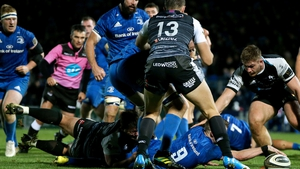Nick McCarthy stretches out for one of Leinster's seven tries against Ospreys