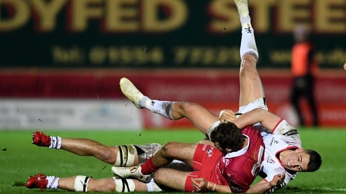 Tom Prydie is tackled by Ulster's James Hume