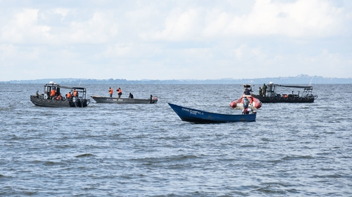 Rescue boats search the waters of Lake Victoria following the accident yesterday