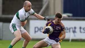 Kilmacud's Andrew McGowan evades Brian McCormack of Portlaoise