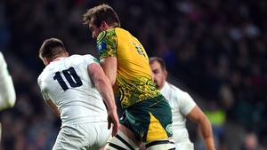 Izack Rodda of Australia is tackled by Owen Farrell