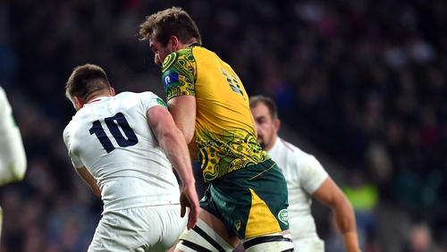 Izack Rodda of Australia is tackled by Owen Farrell