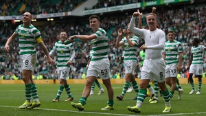 Celtic players celebrate their September defeat of Rangers