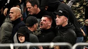 Bloodied spectators inside the stadium