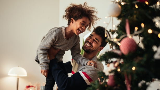 father and daughter celebrating Christmas with love at home.