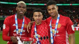 Paul Pogba, Jesse Lingard and Marcus Rashford celebrate the 2018 League Cup success