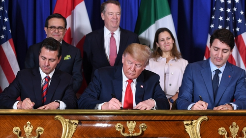 Mexico's President Enrique Pena Nieto, US President Donald Trump, and Canadian Prime Minister Justin Trudeau sign a new free trade agreement