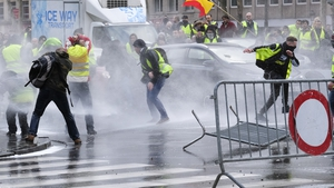 Police use water cannon to disperse the protesters