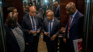 President of South African FA Danny Jordaan (c) pictured in an elevator after an extraordinary meeting with CAF executives