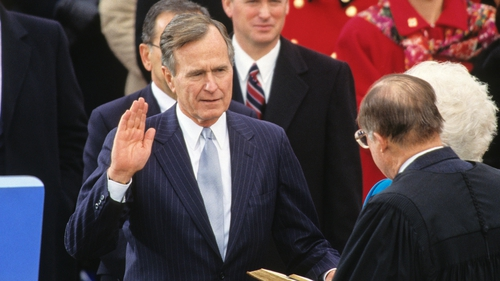 George HW Bush takes the oath of office as he is sworn-in as 41st President of the United States in 1989