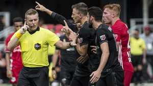 Alan Kelly (L) stays in control during the clash between DC United and the New York Red Bulls