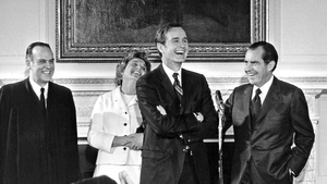 The new CIA director shares a joke with Richard Nixon at his swearing-in ceremony