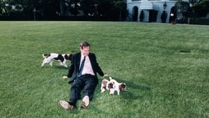 President George Bush sits on the White House lawn with  spaniel Millie and puppies on 4 May 1989