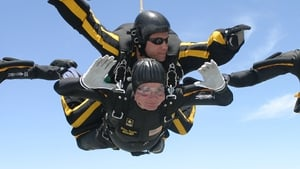 Harnessed to Staff Sergeant Bryan Schell George HW Bush  parachutes in celebration of his 80th birthday in 2004