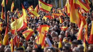 People attend a demonstration called by the far-right party VOX against Catalan separatists