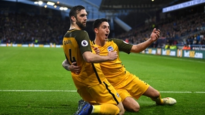 Shane Duffy celebrates his goal with defensive partner Lewis Dunk