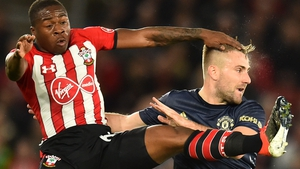 Michael Obafemi (L) competes with Luke Shaw