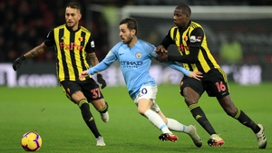 Bernardo Silva of Manchester City takes on Abdoulaye Doucoure (16) and Roberto Pereyra of Watford (37)