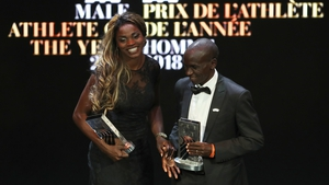 Kipchoge and Ibarguen with their awards