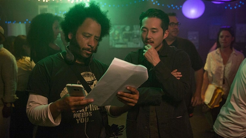 Boots Riley with Steven Yeun while filming Sorry to Bother You
