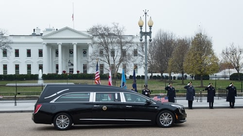 The body of the 41st President of the United States passing the White House today