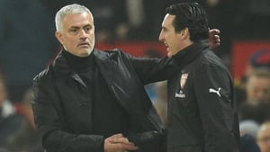 Jose Mourinho (L) shakes hands with Arsenal head coach Unai Emery