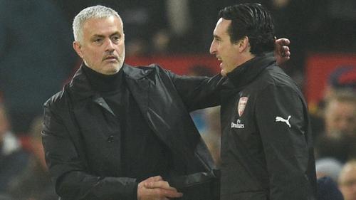 Jose Mourinho (L) shakes hands with Arsenal head coach Unai Emery