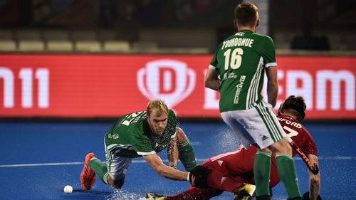 Ireland's Conor Harte battles with Liam Sanford for possession during the World Cup defeat to England