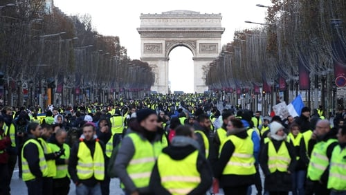 """Donning their distinctive yellow vests, la France des invisibles of lorry drivers, factory workers, carers, shop assistants and many others began to be seen again"""
