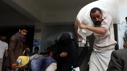 Conflict-affected Yemenis receive rations of food aid provided by the World Food Programme